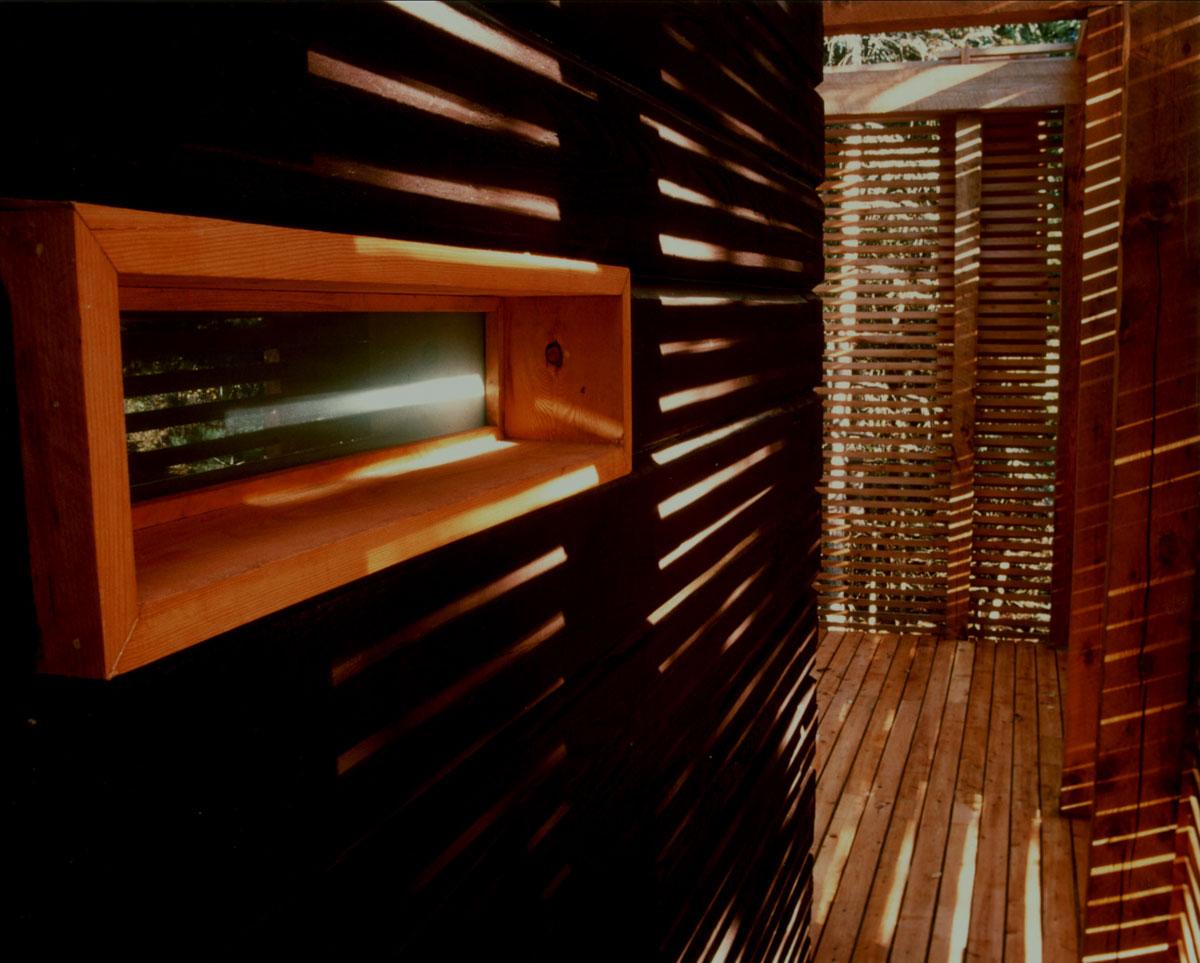 Log sauna wall and window