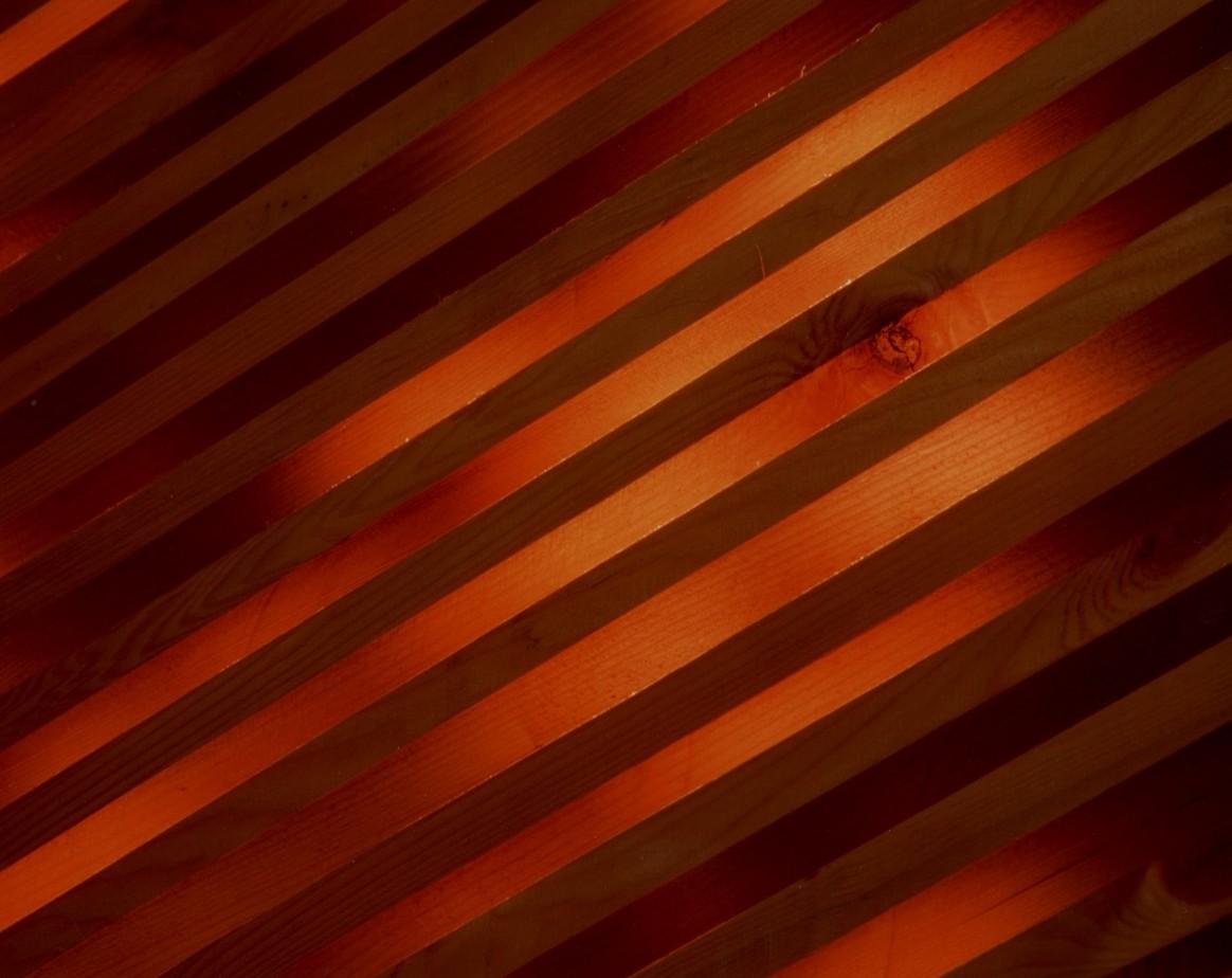 Sauna lattice highlighted by evening summer sun
