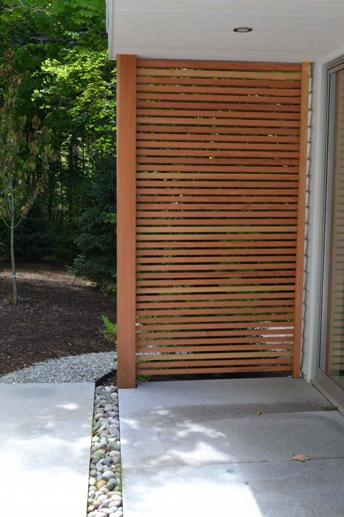 Painting Studio lattice wall, covered porch and granite patio