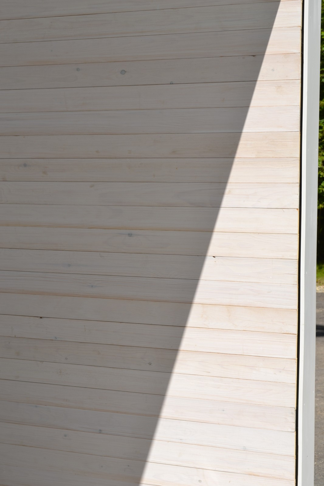 Painting Studio white washed exterior cedar wall