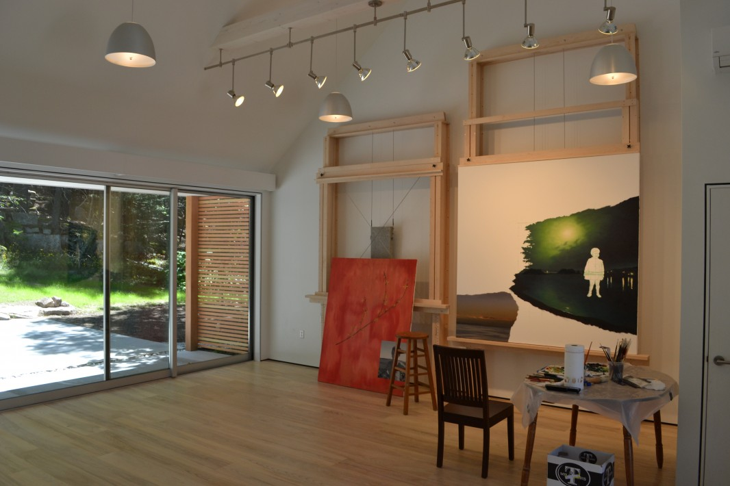 Studio interior, easel and glazed wall
